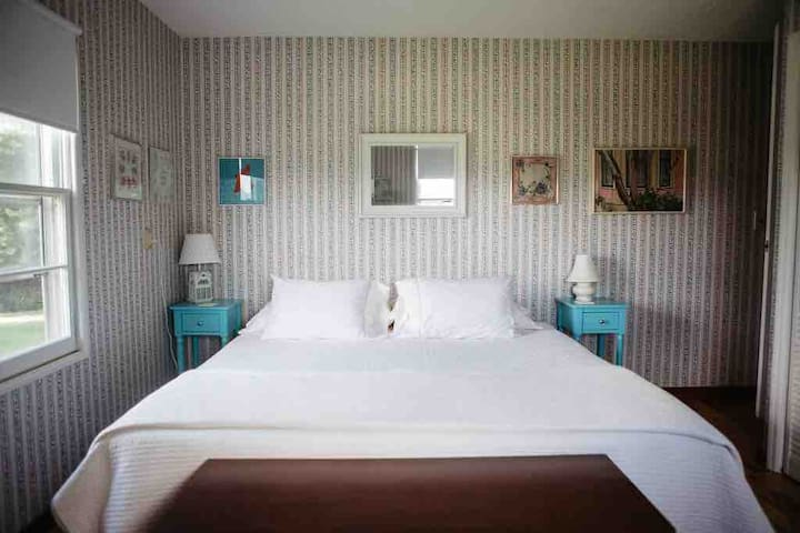 Master Bedroom with Helix King Bed.   Bedroom has private half bathroom.