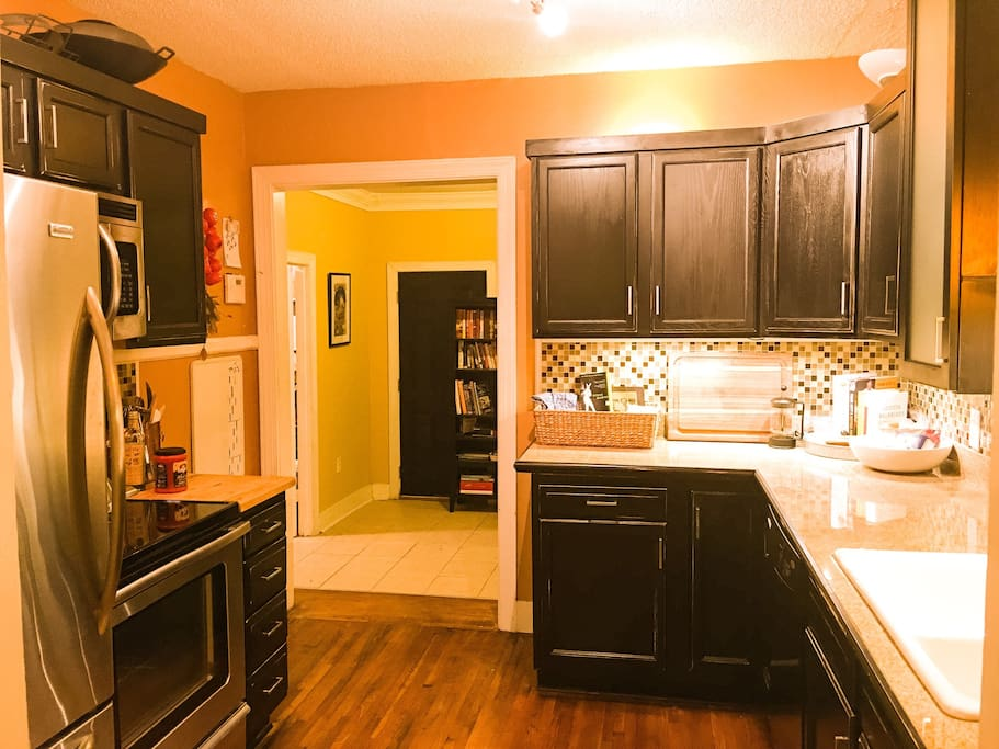 Cute kitchen looking from the dining room into the mud room!!