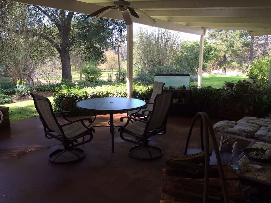 Relaxing outdoor patio looking out over Mokelumne River greenery perfect for morning coffee to evening enjoyment!