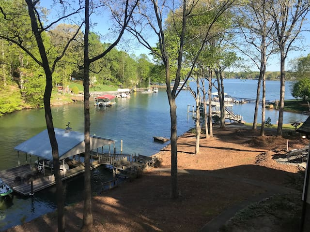 Enjoy this view from the screened porch of this large one-bedroom waterfront guest house overlooking beautiful Lake Norman.