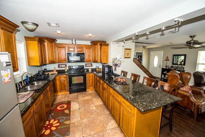 Spacious kitchen; granite tops; hardwood maple cabinets.