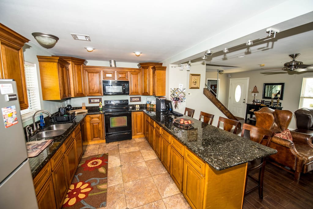Spacious kitchen; granite tops; hardwood maple cabinets.