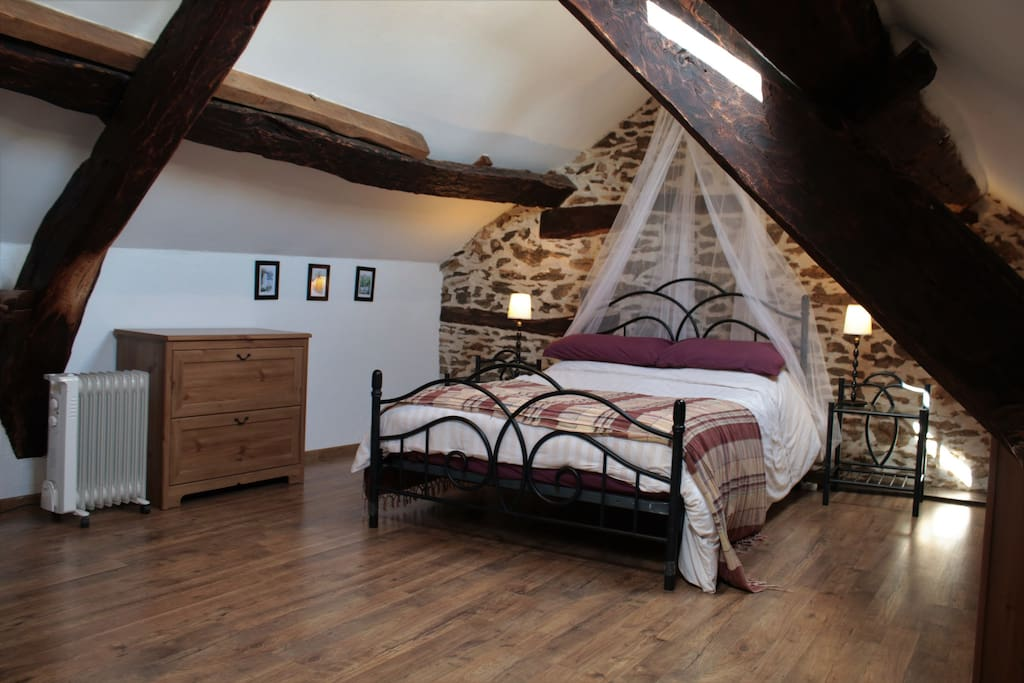 Romantic master bedroom up in the eves.