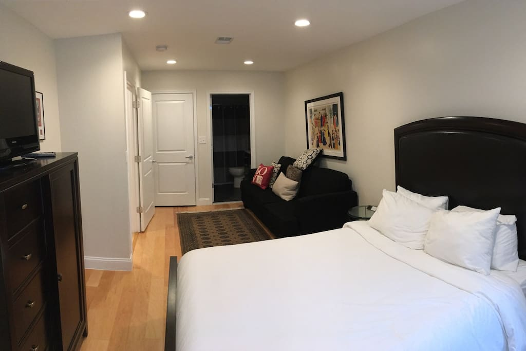 Master bedroom suite with attached private bathroom