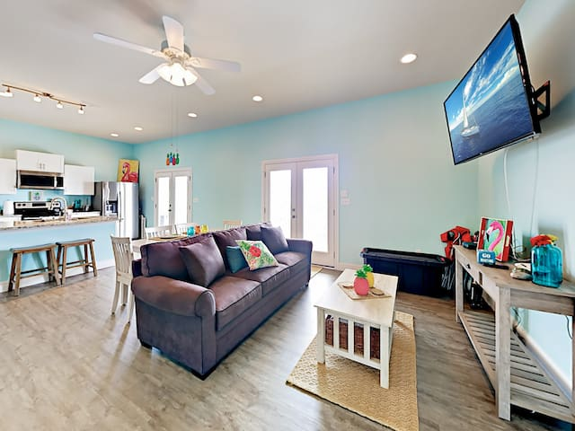 "Spend time together in the open living area, furnished with a 60"" Roku TV. Complimentary Wi-Fi provided."