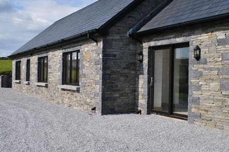 modern stone house with views of the mizen . - Schull
