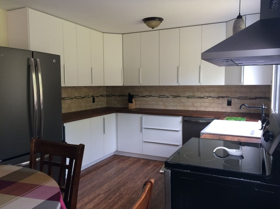 The kitchen has lots of countertop space and storage, and is stocked with all the essentials!