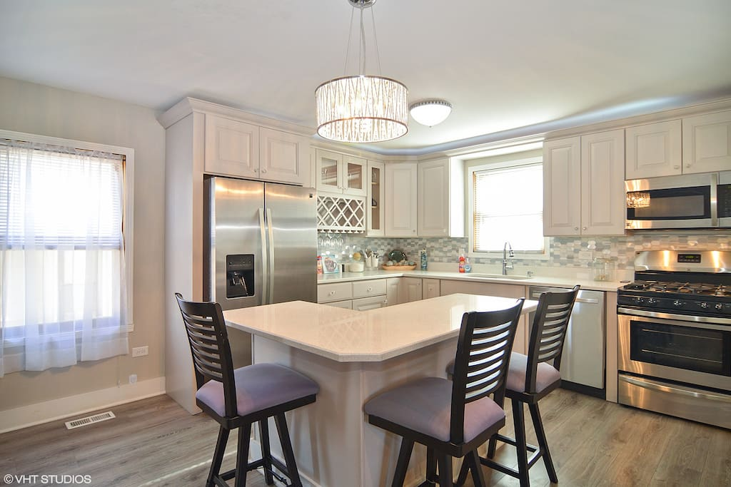 Our beautiful custom kitchen, with  fridge, stove, dishwasher, quartz countertops