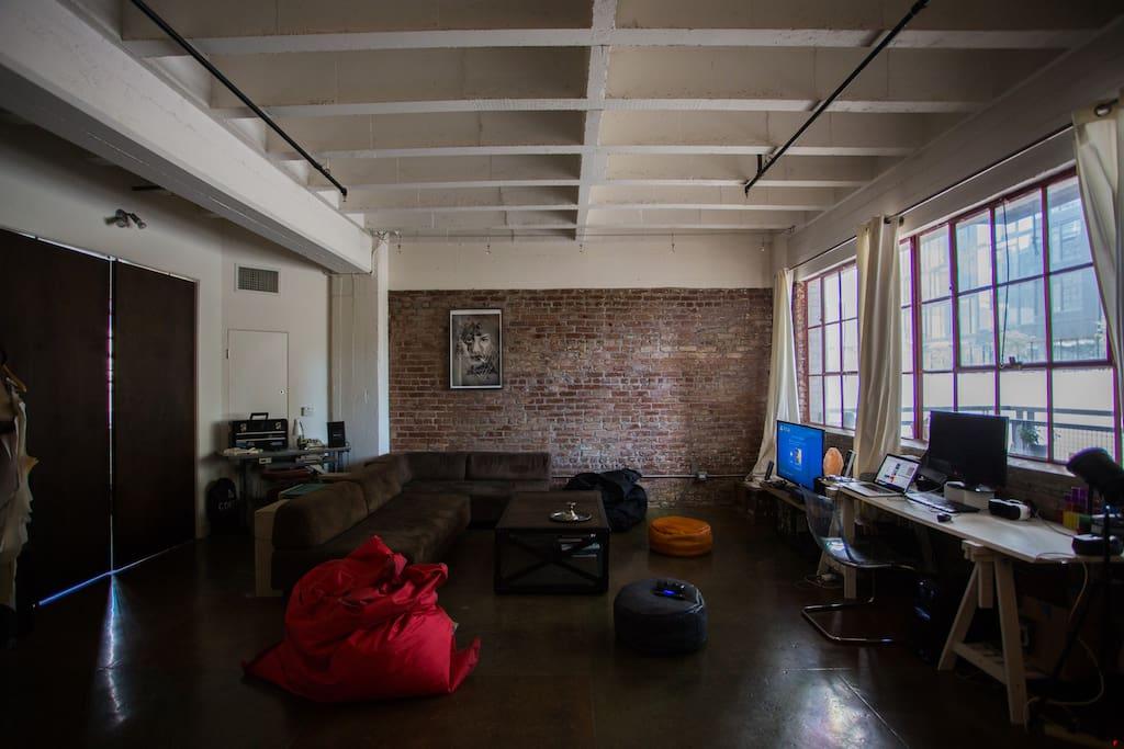 Shared Living Room & Workstation.
