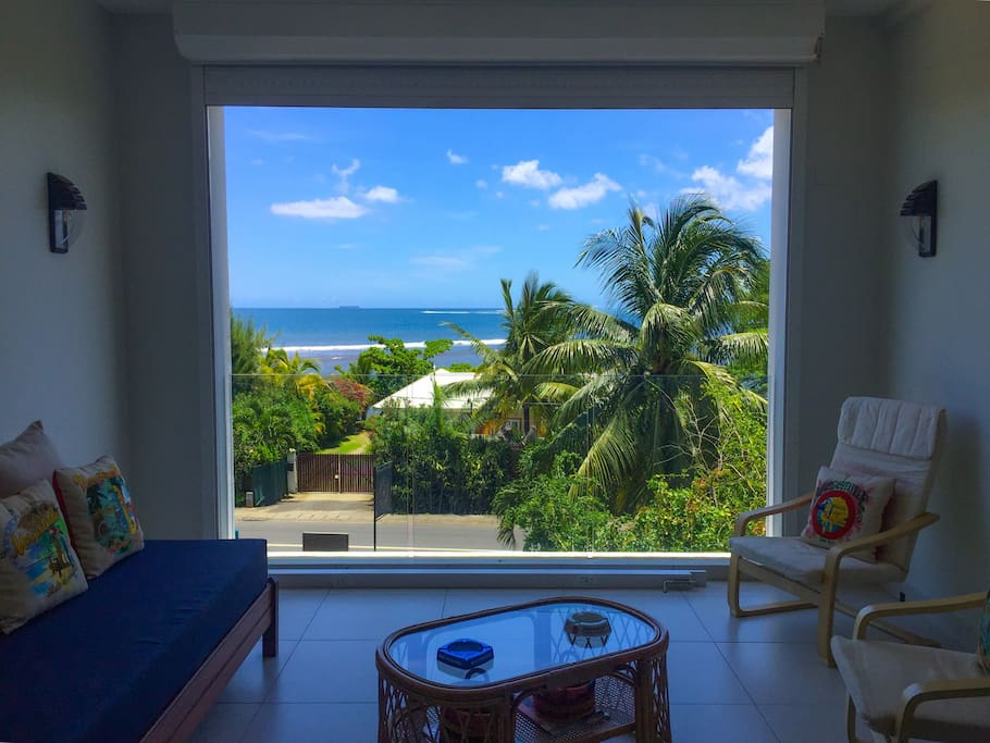 The balcony enjoys a spectacular view of the ocean and the beautiful town of Tamarin