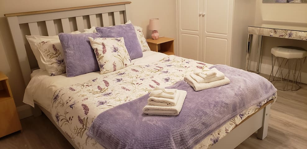Larger bedroom with double bed