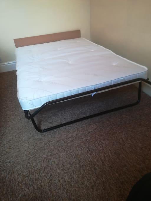 Bed showing sprung mattress