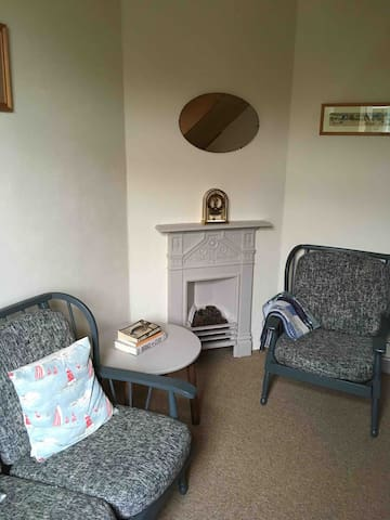 Study ,leading to upstairs lounge family space , lovely decorative fireplace .