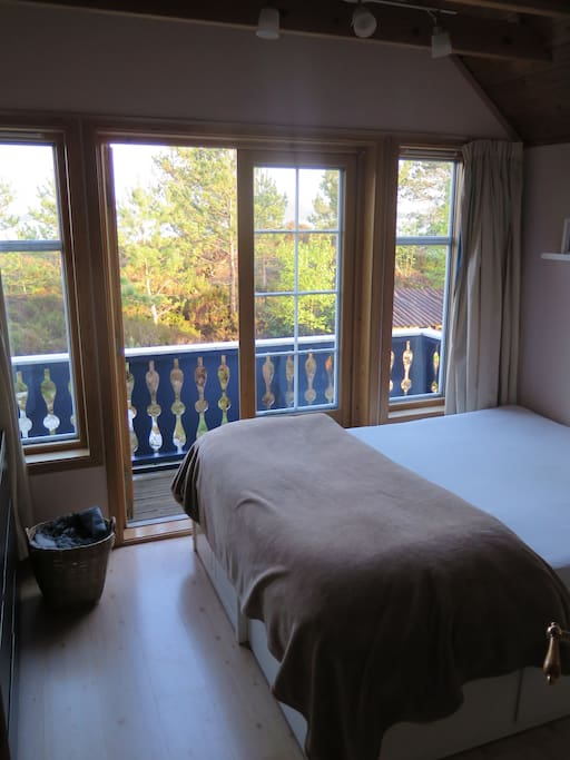 Bedroom 1, double-bed with balcony and view of the fjord
