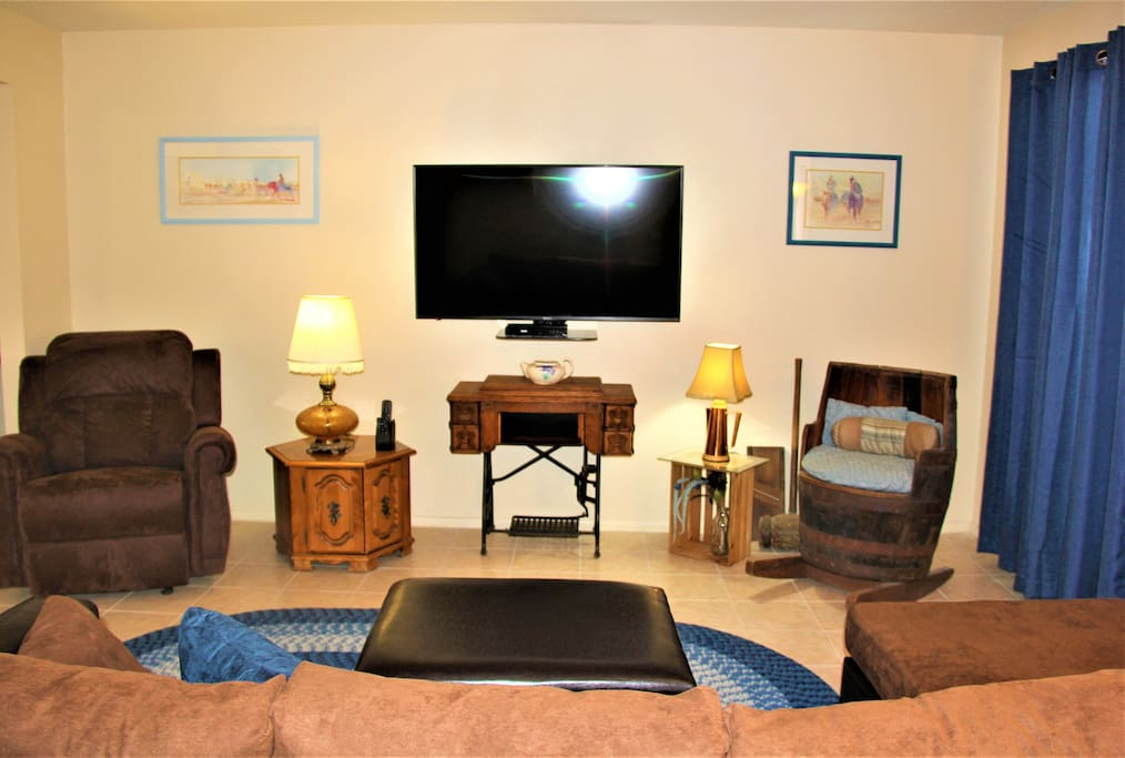Antiques and Artwork Mixed with Modern Comfort, Huge TV