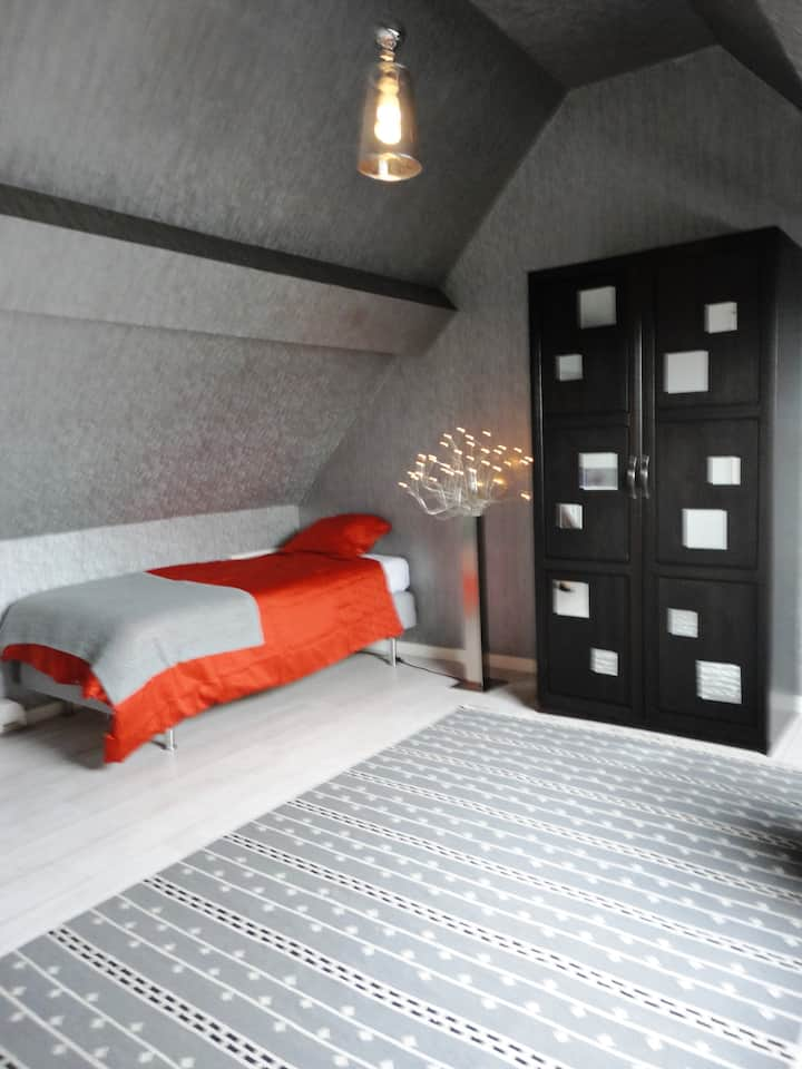 Chambre au calme sous le toit