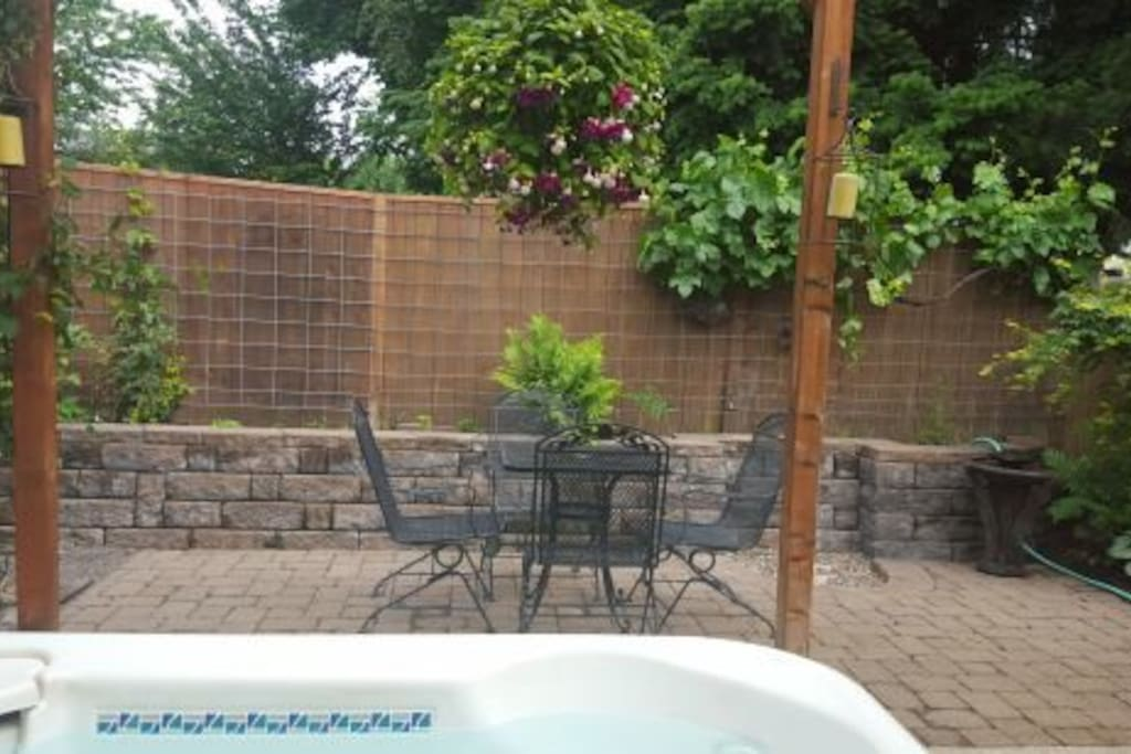 Three-man hot tub, small private patio in back.