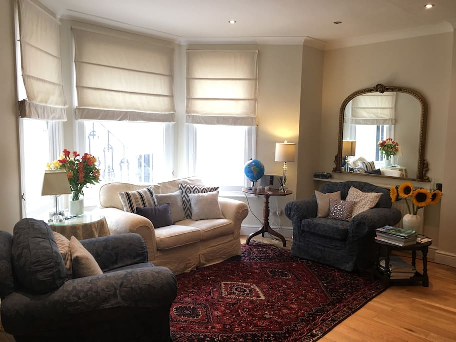 Living room is bright and open to the kitchen. Free WiFi in all rooms.