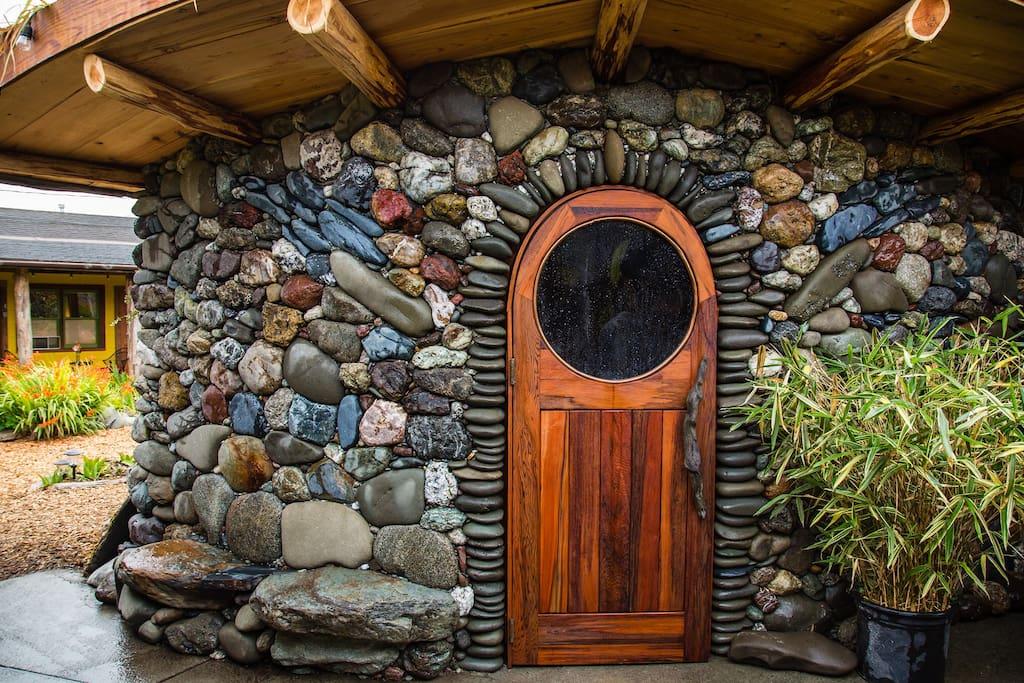 Custom Cedar Sauna with Riverstone exterior