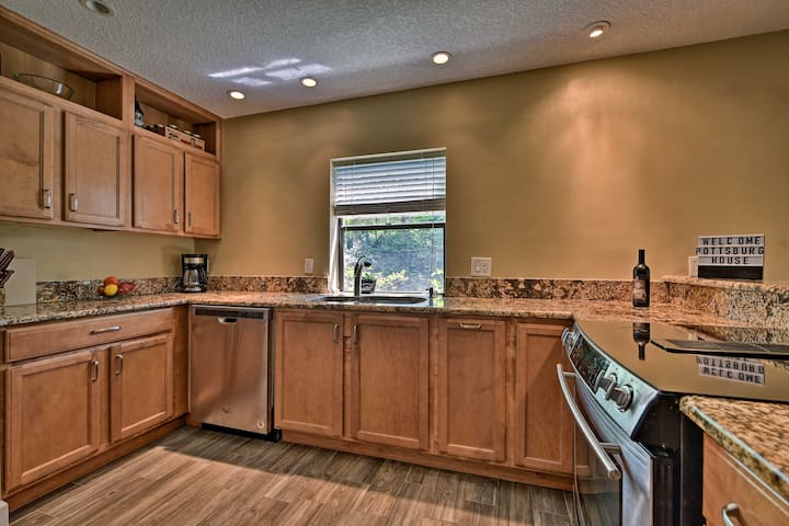 The fully equipped kitchen offers stainless steel appliances & granite counters.