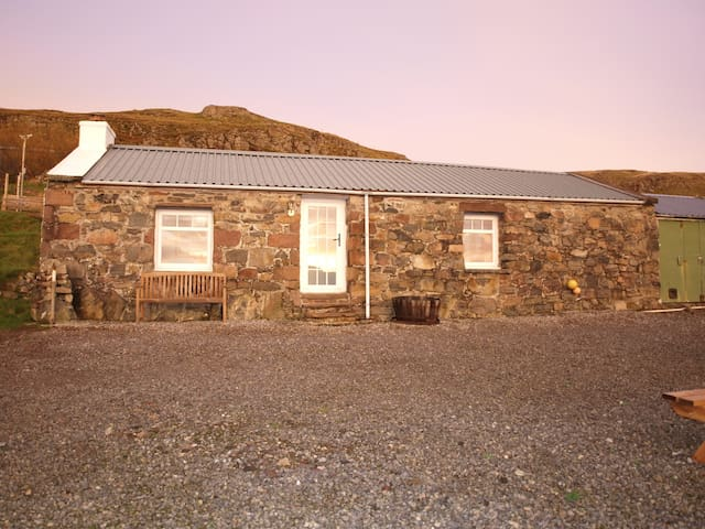 The  Bothy reflecting a winter sunrise