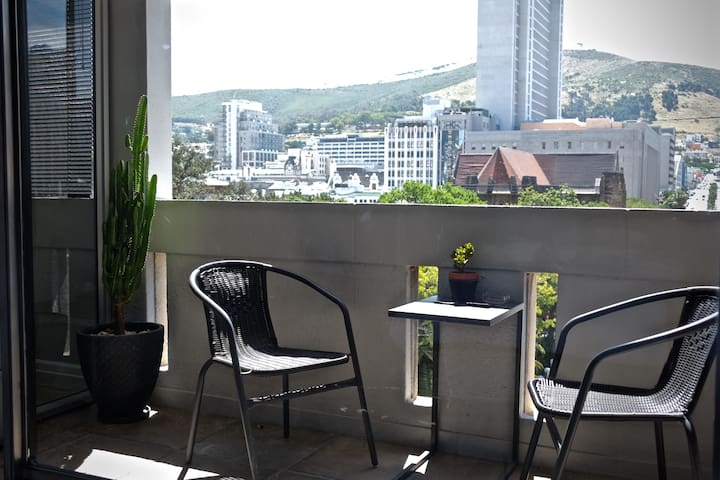 Balcony seating outside the bedroom with Company's Garden & west side of city beyond