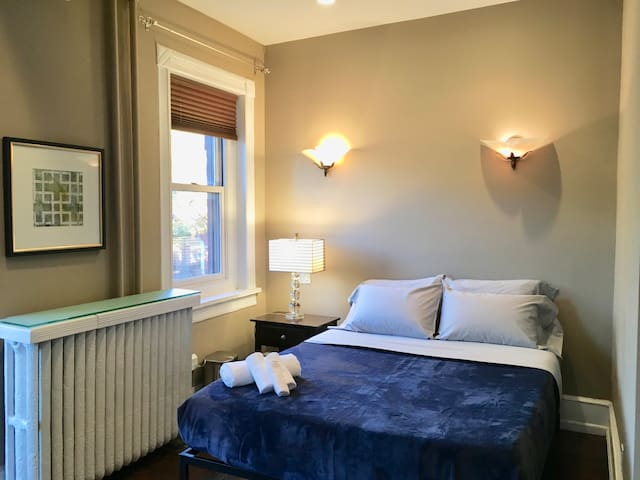 Master Suite in Charming Logan Victorian Townhome