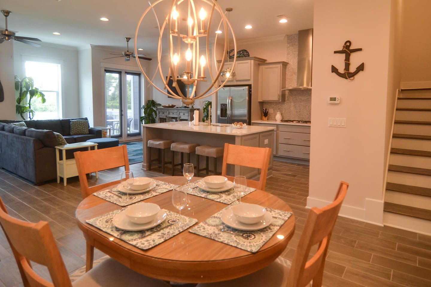 Spacious, open concept living/kitchen/dining areas with access to deck through two sets of french doors