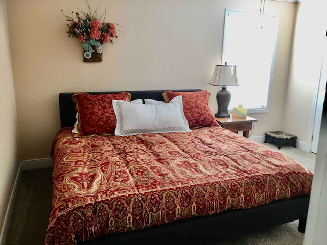 Very very comfortable King size bed in master bedroom with desk, chair and smart tv