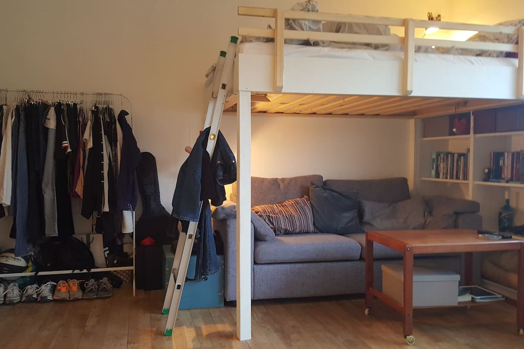 Coucharea, bed and wardrobe.