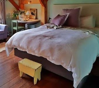 Choose the beautiful sunny room with a queen and single bed, direct access to the cosy mezzanine and shared industrial bathroom facility provide a unique barn living stay