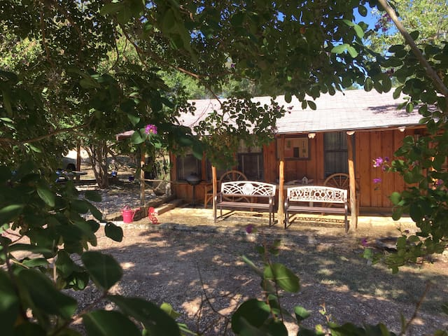 Main entry patio, located next to carport and plenty of other parking.  Usually very quiet and serene here on this patio at night, where you will see countless stars in the sky on a clear night, as well as lots of fireflies on certain nights ....