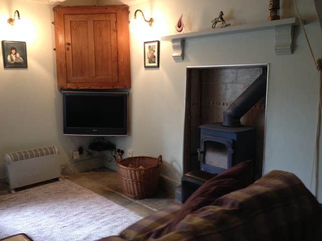 Cosy sitting room with TV and log burning stove
