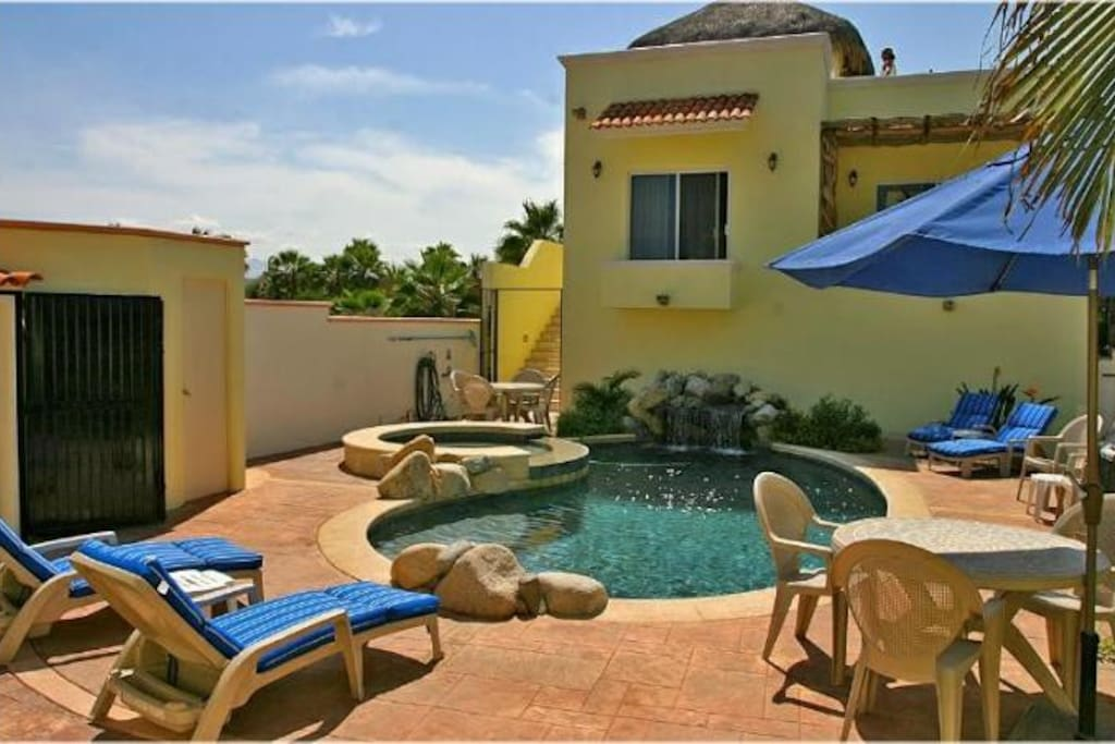 Your heated swimming pool, Jacuzzi, and waterfall!