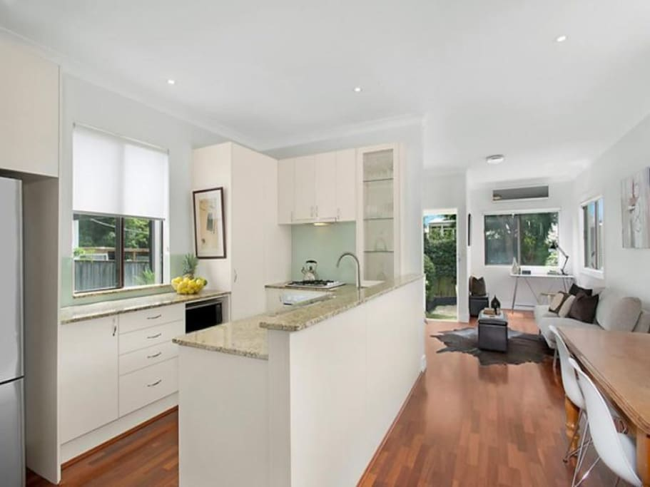 Open plan kitchen with gas cooktop, fan-forced oven, and microwave