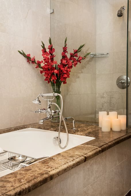 Get ready for the day ahead in the large and bright bathroom.