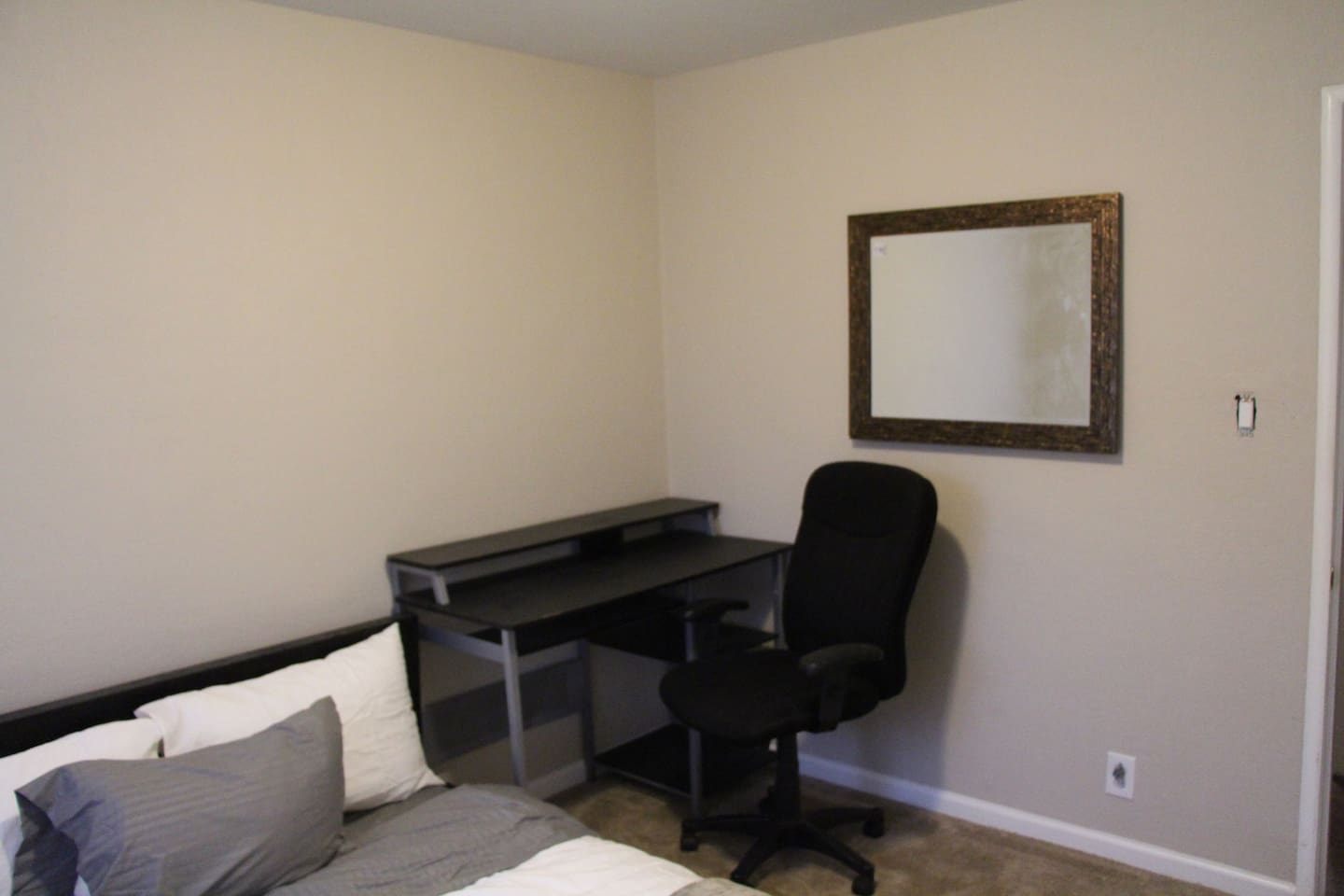 Black desk  with office chair and mirror