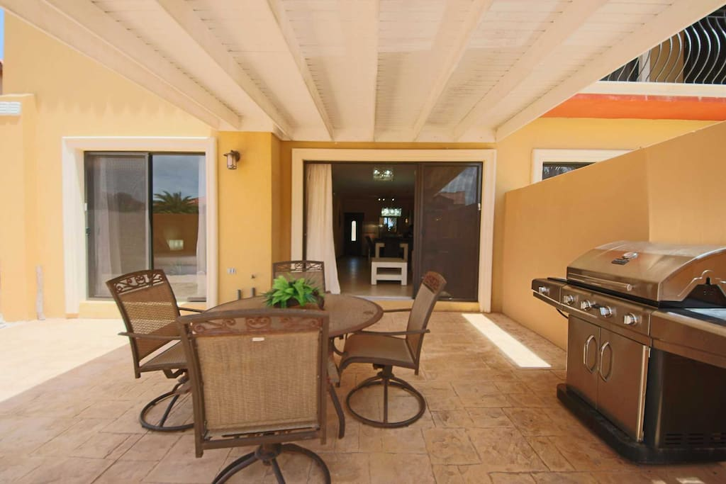 The veranda with a BBQ-grill and 4-seat dining table