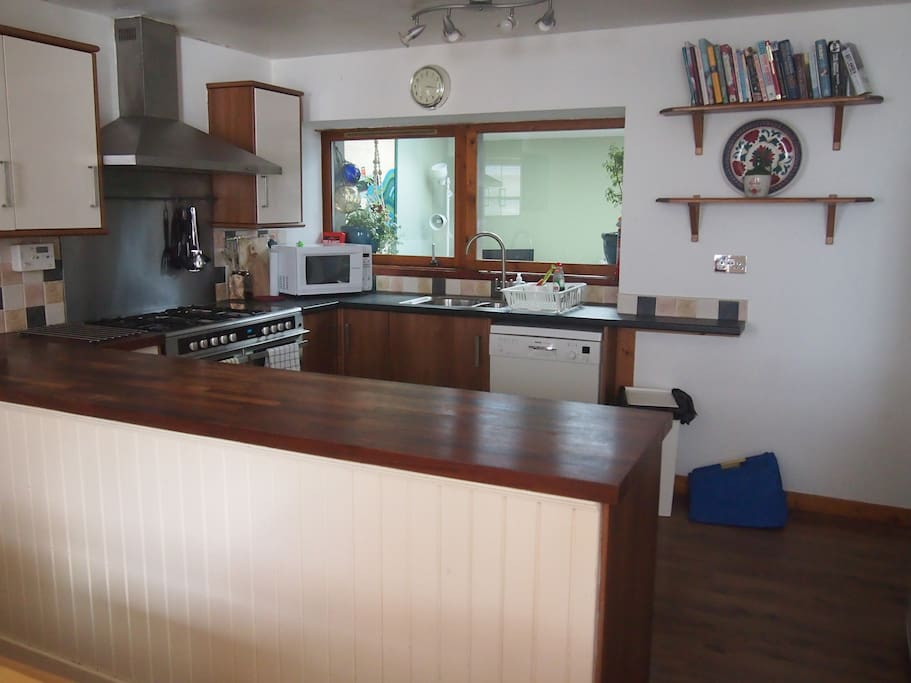 Lots of space, storage, full size dishwasher,  loads of preparation area on hardwood worktop.
