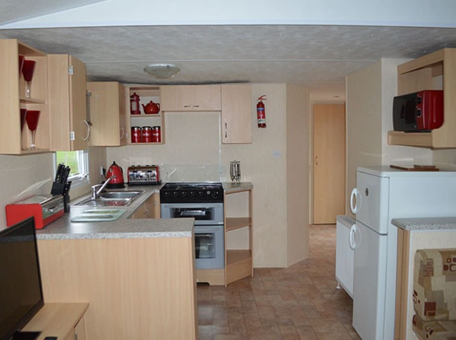 Fully equipped kitche area with cooker, microwave, fridge freezer, toaster, kettle etc