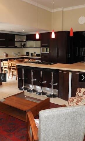 Kitchen and informal Lounge