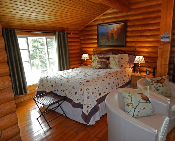 Beautiful bedroom area with warm quilts for Julian winters, plus hardwood floors.