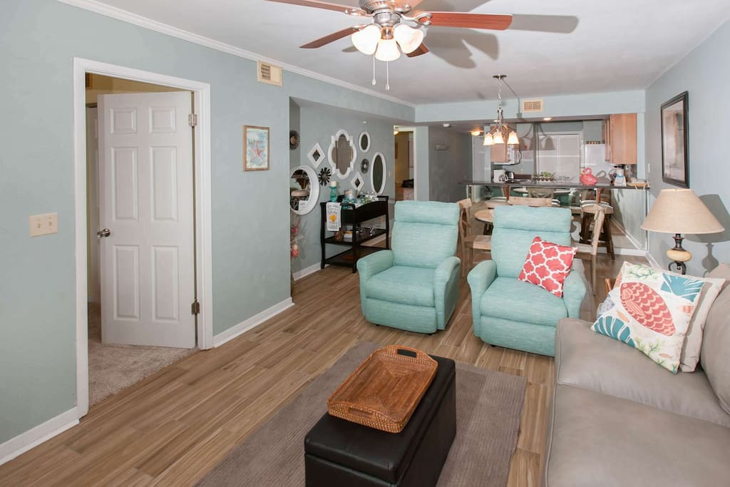 Living room with two recliners looking towards dining room and kitchen