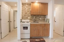 Apartment kitchenette with stove and sink