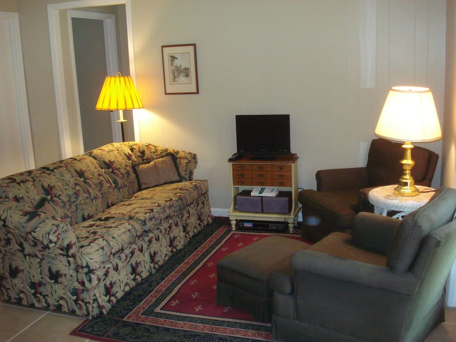 another view of the sitting room which is equipped with a nice stereo system and a small TV screen and DVD player for watching movies.  Bring your favorite CD's and DVD's!
