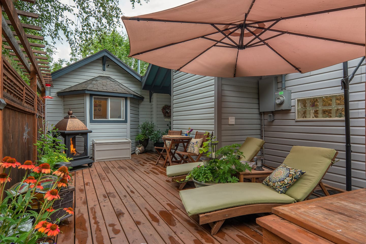 Welcome Home to Cottage House!  Your private deck provides 2 lounge chairs, a table for two, fireplace and umbrella. Your entry door is on this deck. The window near the fireplace is your bathroom, your bedroom is connected to the bathroom. Book it!