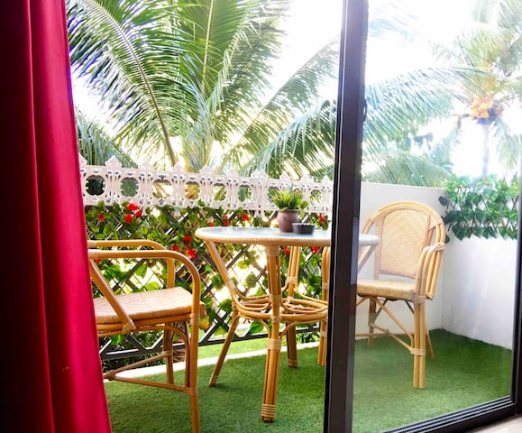 Our beautiful outdoor sitting area. The coconut trees give you the feel of being in the tropical island. You can sit comfortably and have your wine with cheese.