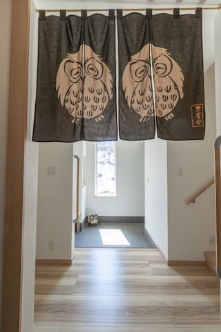 View from the shoes room leading to the second entrance into Owl House