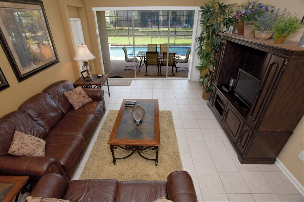 Spacious living area with 32-inch HDTV, DVD player, surround sound system and direct pool/patio acce