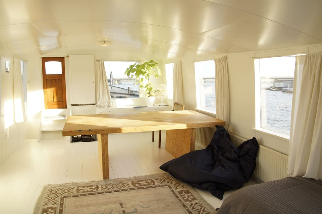 Bedroom in the top floor of the boat with amazing views of the lake, birds and sun.
